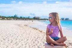 Adorable little girl sitting in a lotus position Royalty Free Stock Photo