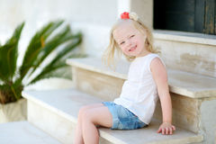Adorable little girl sitting on stairs Stock Photography