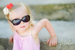 Adorable little girl sitting on stairs Stock Images