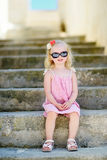 Adorable little girl sitting on stairs Royalty Free Stock Photo
