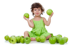 Adorable Little Girl Sitting With Green Apples Royalty Free Stock Image
