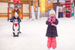 Adorable little girl on skating rink with father Royalty Free Stock Photography