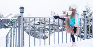 Adorable little girl skating in winter snow day Royalty Free Stock Images