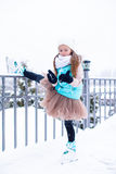 Adorable little girl skating in winter snow day Stock Photos