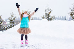 Adorable little girl skating in winter snow day Royalty Free Stock Photography