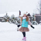 Adorable little girl skating in winter snow day Royalty Free Stock Photos