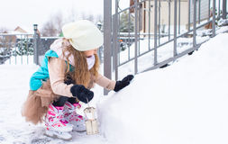 Adorable little girl skating in winter snow day Royalty Free Stock Photo
