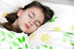 Adorable little girl sleep in the bed Stock Photo