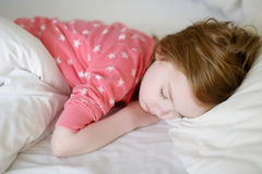 Adorable little girl sleeping. In a bed Royalty Free Stock Photo