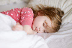 Adorable little girl sleeping. In a bed Royalty Free Stock Images