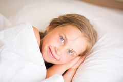 Adorable little girl sleeping. In the bed Stock Image