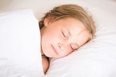 Adorable little girl sleeping. In the bed Stock Photography