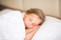 Adorable little girl sleeping. In the bed Royalty Free Stock Image