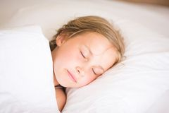 Adorable little girl sleeping. In the bed Royalty Free Stock Photo