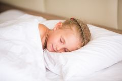 Adorable little girl sleeping. In the bed Royalty Free Stock Images