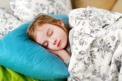 Adorable little girl sleeping. In a bed Royalty Free Stock Photography
