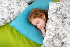 Adorable little girl sleeping. In a bed Royalty Free Stock Image