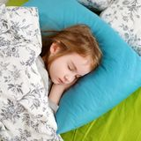 Adorable little girl sleeping. In a bed Stock Photography