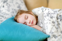 Adorable little girl sleeping. In a bed Stock Images