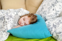 Adorable little girl sleeping. In a bed Stock Photo