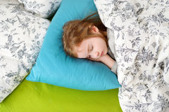 Adorable little girl sleeping. In a bed Stock Image