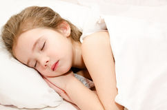 Adorable little girl sleeping in bed Stock Photos