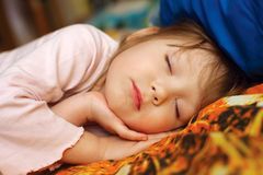 Adorable little girl sleeping in a bed. Adorable little girl sleeping in her bed Royalty Free Stock Photography