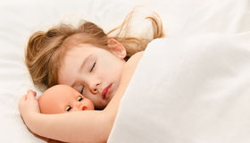 Adorable little girl sleeping in the bed Royalty Free Stock Images