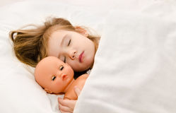 Adorable little girl sleeping in the bed Royalty Free Stock Photos