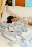 Adorable little girl sleeping in a bed,. Look at camera Royalty Free Stock Photo