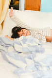 Adorable little girl sleeping in a bed. Look at camera Stock Photos