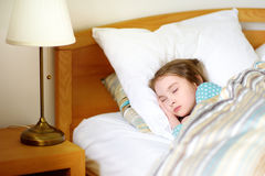 Adorable little girl sleeping in the bed Stock Photo