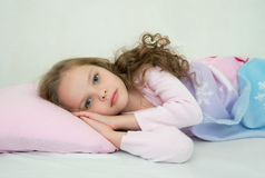 Adorable little girl sleeping in her bed Stock Photos