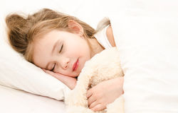 Adorable little girl sleeping in her bed Royalty Free Stock Images