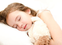 Adorable little girl sleeping with toy Royalty Free Stock Image