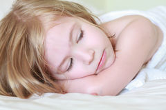 Adorable little girl sleeps. Stock Images