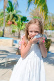 Adorable little girl with a small turtle in her hands in the natural reserve Royalty Free Stock Photography