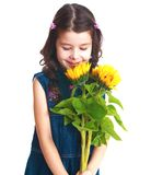 Adorable little girl is smelling flowers Royalty Free Stock Photography