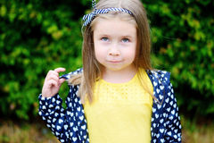 Adorable little girl smiling in a park. Adorable girl smiling in a park Stock Photo