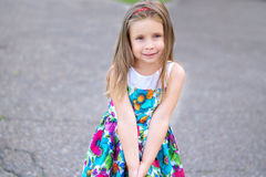 Adorable little girl smiling in a park. On summer day Royalty Free Stock Photography