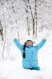 Adorable little girl in snow winter forest royalty free stock photos