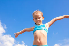 Adorable little girl spread her arms background of Stock Photo