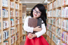 Adorable little girl standing in library Royalty Free Stock Photos