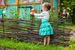 Adorable little girl standing near vintage wooden Royalty Free Stock Image