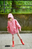 Adorable little girl standing in a poodle Royalty Free Stock Photos