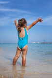 Adorable little girl standing on tropical beach Royalty Free Stock Image