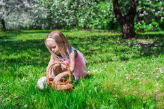Adorable little girl with straw basket in. Little adorable girls with butterfly wings under blossoming apple tree Royalty Free Stock Photography