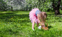 Adorable little girl with straw basket in Stock Photos
