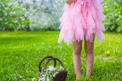 Adorable little girl with straw basket in. Little adorable girls with butterfly wings under blossoming apple tree Royalty Free Stock Images