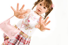 Adorable little girl stretching out hands Stock Images